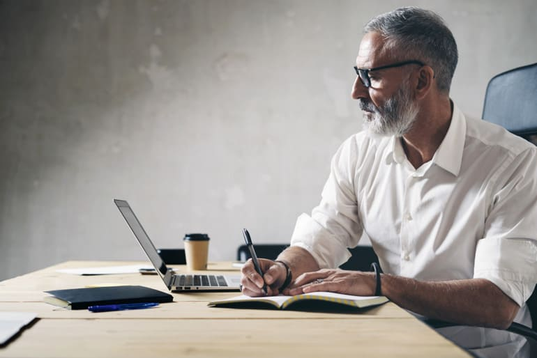 Man analyzing work at computer