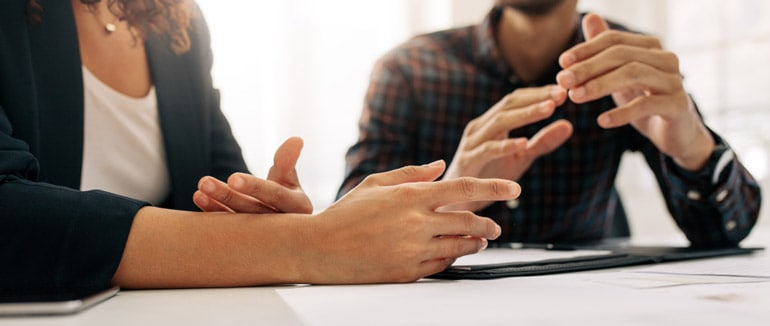 Close up of two business people talking using their hands