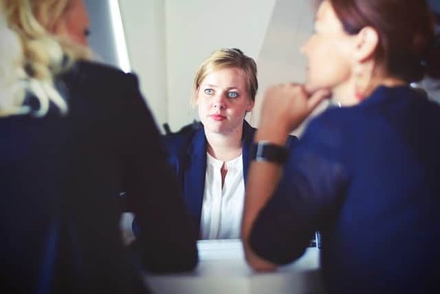 Woman at desk looking like she has made a mistake