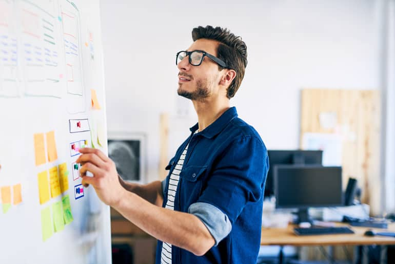 Man using agile approaches on white board