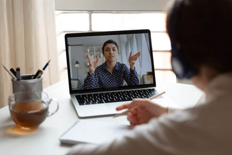 Woman in computer meeting asking why