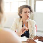 Woman discussing resource planning and management in a meeting